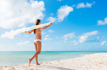 Beautiful Young Woman Relaxing Tropical Island. Walking on White Sandy Beach. Vacation Travel Concept.