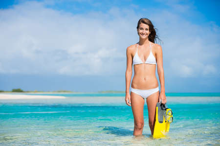 woman diving: Beautiful Young Woman on Tropical Beach with Snorkel Gear Stock Photo