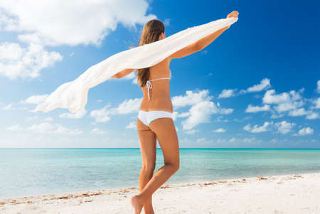 Beautiful Young Woman Relaxing Tropical Island. Walking on White Sandy Beach. Vacation Travel Concept. photo