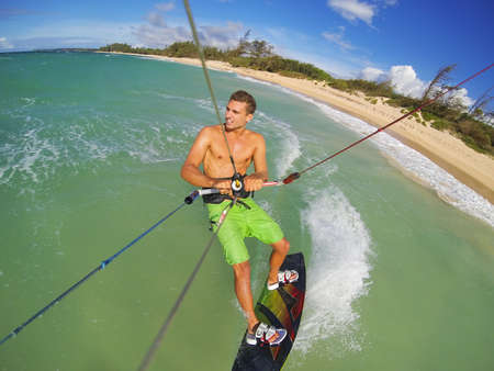 kitesurfing: Kiteboarding, Fun in the Ocean, Extreme Sport.  Stock Photo