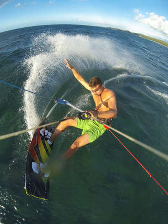kite surfing: Kiteboarding, Fun in the Ocean, Extreme Sport. Action Camera POV angle.