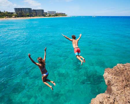 cliff jumping: Summer fun, Friends cliff jumping into the ocean.