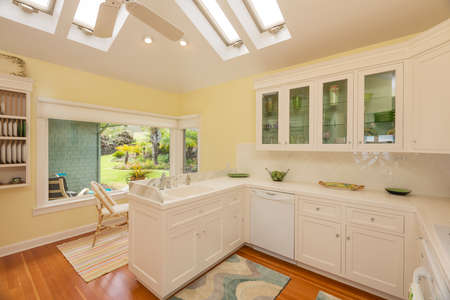 Classic kitchen in beautiful bright home with wood floors photo