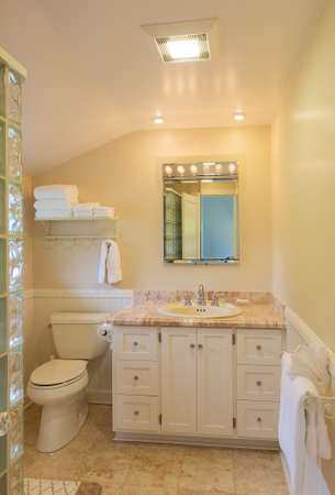 Beautiful bathroom in classic home with marble tile and countertop   photo