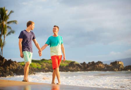 Happy gay couple on the beach photo