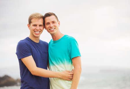 Happy loving gay couple on the beach photo