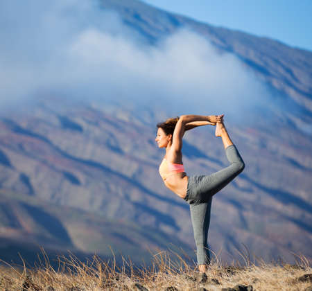 Woman Practicing Yoga Outdoors Stock Photo Picture And Royalty Free