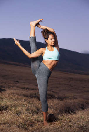 yoga girl: Attractive woman practicing yoga outdoors at sunset
