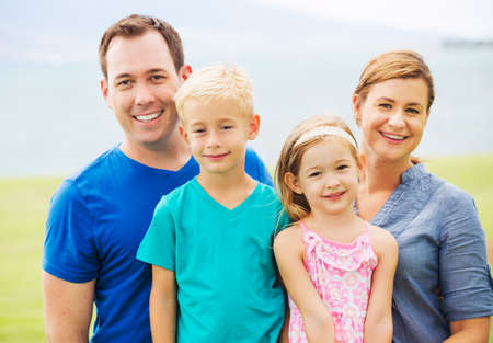 Portrait of Happy Family Outside photo