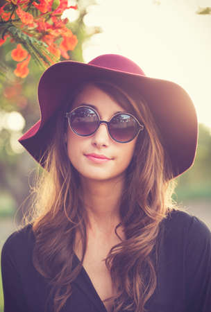 fashion: Fashion Portrait of Beautiful Stylish Young Woman in Hat and Sunglasses