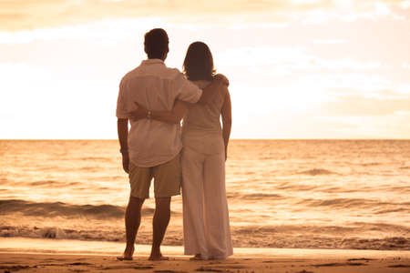 Romantic Mature Couple Enjoying at Sunset on the Beach in Hawaii Stock Photo - 31332496