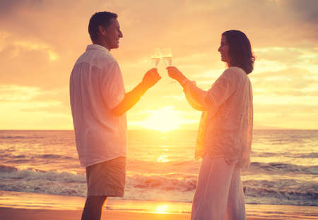 Romantic Retired Couple Drinking Champagne to Celebrate on Vacation  photo