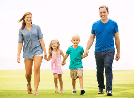Happy Family Outside on Grass photo