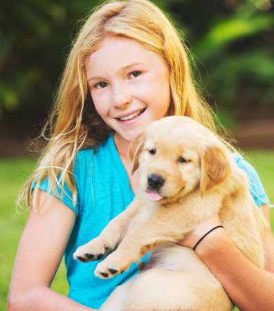Adorable Cute Young Girl with Puppy photo