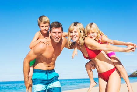 Happy Family Having Fun on the Beach Foto de archivo