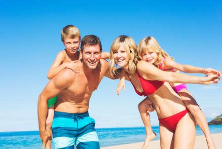 Happy Family Having Fun on the Beach Stock Photo