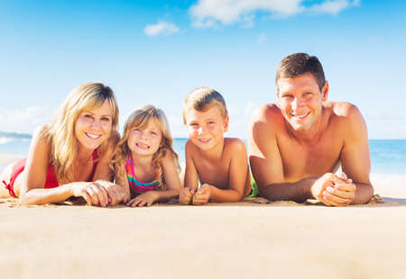 Happy Family of Four on Tropical Beach, Summer Lifestyle Stock fotó