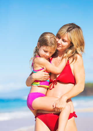 Happy and Loving Mother and Daughter on the Beach, Summer Lifestyle photo