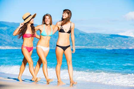 thong woman: Group of Friends Having Fun Walking on Tropical Beach
