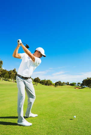 Golfer Hitting Golf Shot with Club on the Course  photo
