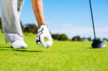 Golfer Placing Golf Ball on the Tee Stock Photo