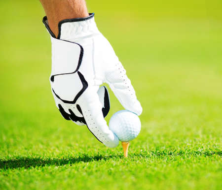 placing: Man Placing Golf Ball on the Tee, Close up Detail  Stock Photo
