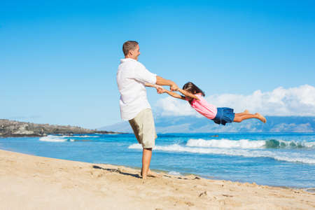 Father and Daughter Playing on the Beach photo