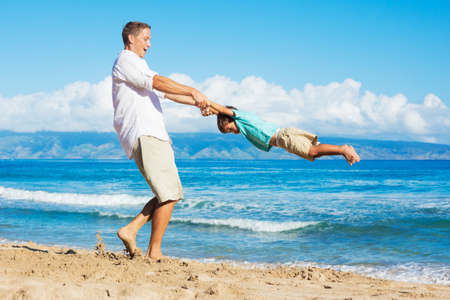 foster: Father and Son Playing on the Beach