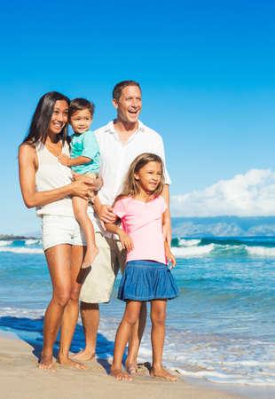 splash mixed: Happy Portrait of Mixed Race Family on the Beach