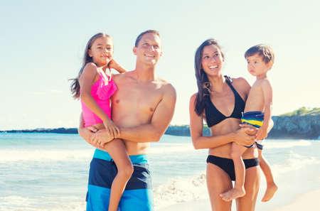 diverse family: Happy Mixed Race Family of Four on Sunny Beach. Tropical Beach Family Vacation.