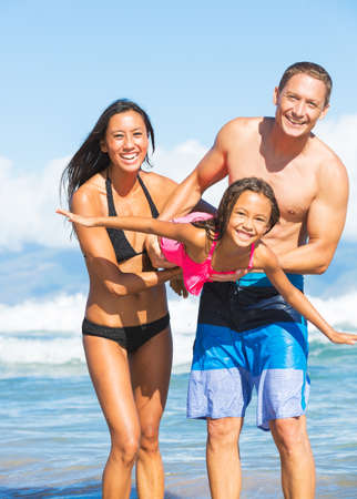 Happy Family Playing and Having Fun on the Beach photo