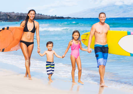 Happy Family with Surfboards on Tropical Beach, Summer Lifestyle Family Concept photo