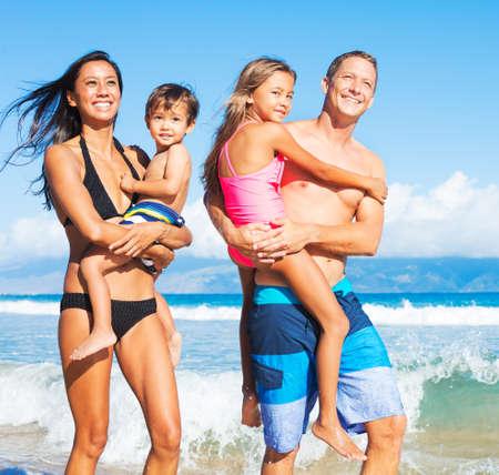 Happy Mixed Race Family of Four on Tropical Sunny Beach Archivio Fotografico