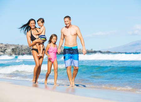 Happy Mixed Race Family of Four on Tropical Sunny Beach Reklamní fotografie