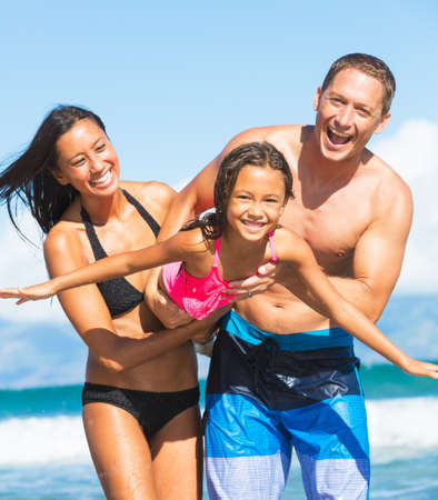 Happy Family Playing and Having Fun on the Beach. Family Tropical Beach Vacaton.