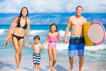 Happy Family with Surfboards on Tropical Beach, Summer Lifestyle Family Concept Archivio Fotografico