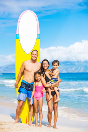 Happy Family with Surfboards on Tropical Beach Фото со стока