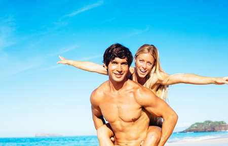 good looking man: Happy Attractive Couple Playing and Having Fun on Beautiful Sunny Beach
