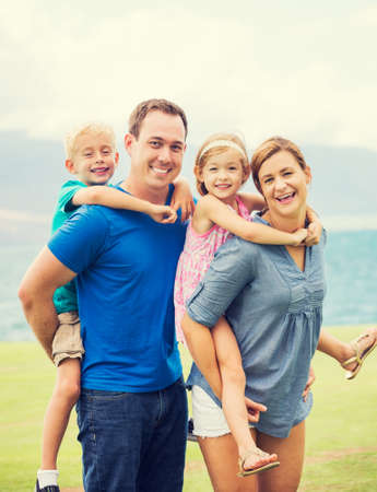 Portrait of Happy Family of Four Outside