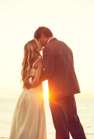bridal dress: Beautiful Sunset Wedding. Bride and Groom at Sunset
