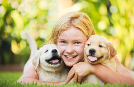 puppy love: Adorable Cute Young Girl Playing and Hugging Puppies