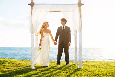 canopy: Wedding. Romantic Bride and Groom in Love on Wedding Day.