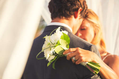 Beautiful Wedding Couple Embracing. Bride and Groom in Love.