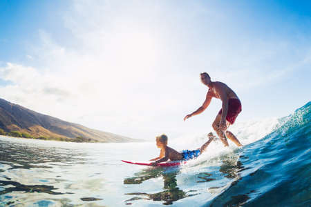 Father and Son Surfing Together Riding Blue Ocean Wave photo
