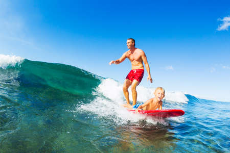 Father and Son Surfing Together Riding Blue Ocean Wave