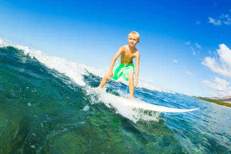 Young Boy Surfing Ocean Wave