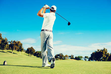 golf club: Golfer Playing on Beautiful Golf Course
