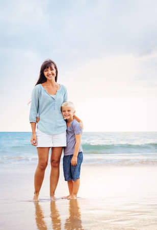 Mother and Son on the Beach by the Sea