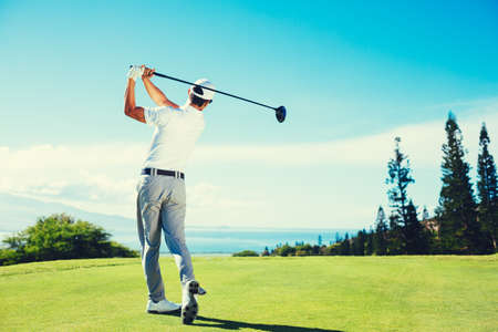 golf swings: Golfer Playing on Beautiful Golf Course