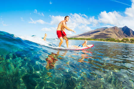 Father and Son Surfing Together photo
